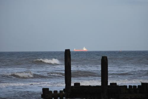 Picture of North Sea with ship and underwater whale